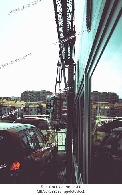 Cars approaching the transporter bridge at Bilbao, aerial transfer bridge, UNESCO World Heritage Site
