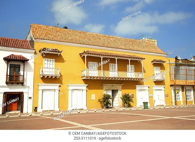 View to the colorful colonial buildings in Plaza De La Aduana Square at the historic center, Cartagena de Indias, Bolivar, Colombia, South America