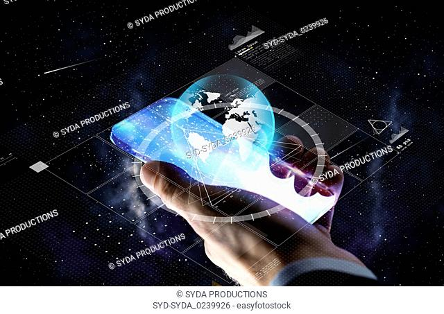 hand with smartphone and earth projection