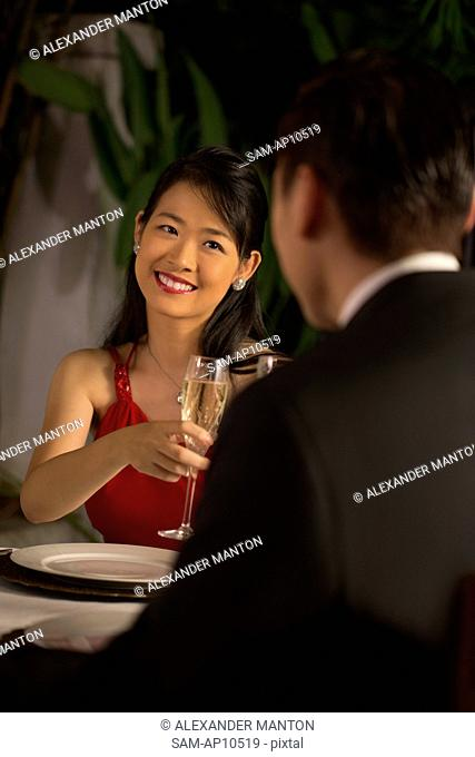 Singapore, Woman and man at formal dinner in restaurant