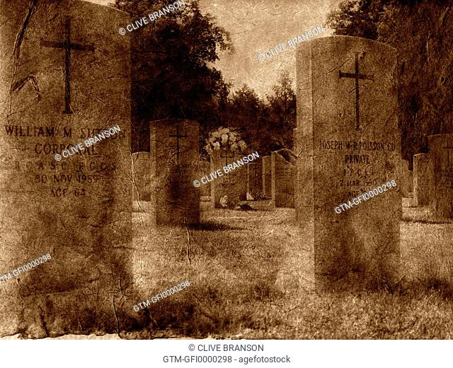 Creased photograph of grave stones in a graveyard