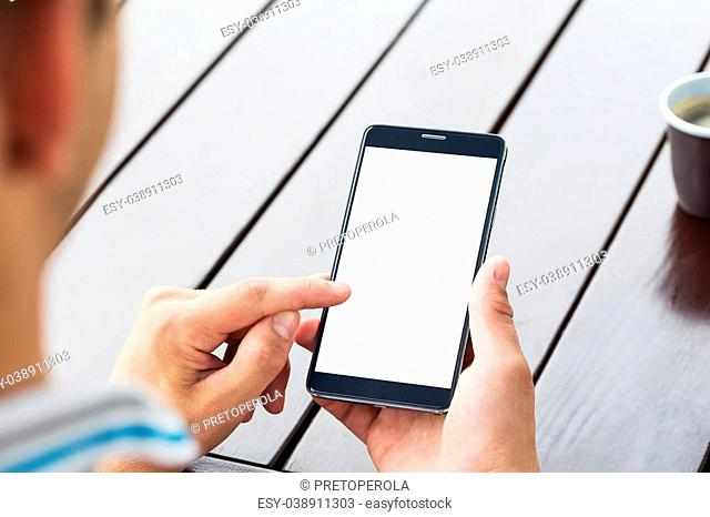 Man holding smart mobile phone on wooden table background