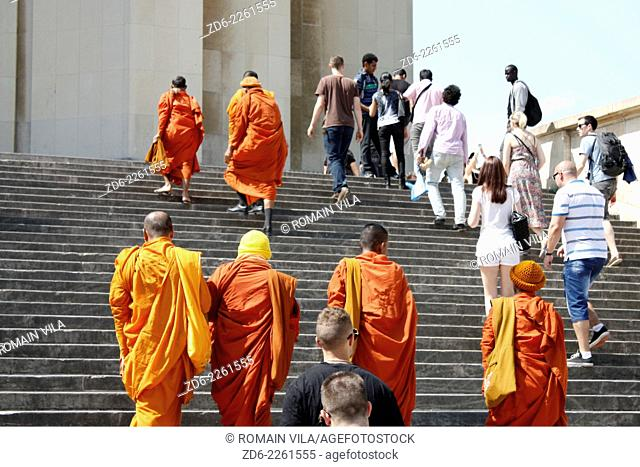 Tibetan monks on the steps of the palace of Chaillot near the esplanade of the Trocadero, Paris, Ile de France, France, Europe