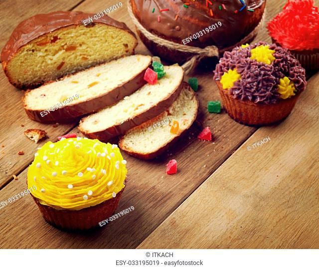 Easter bread and cakes on the wooden table closeup
