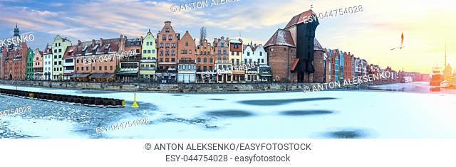 Gdansk winter panorama of the Motlawa embankment with Zuraw Port Crane and other old buildings.