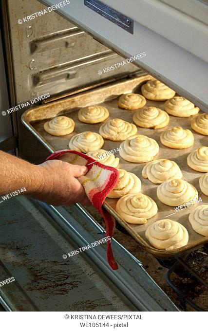 A tray of Anise Cookies coming out of the oven
