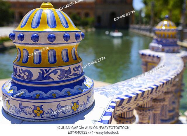 Colored ceramic decoration details at Plaza de Espana, Seville, Andalusia, Spain. Balustrade top
