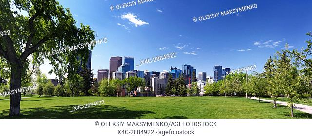 Panoramic scenery of Calgary city downtown skyline and Sunnyside Bank Park on a sunny summer day. Calgary, Alberta, Canada 2017