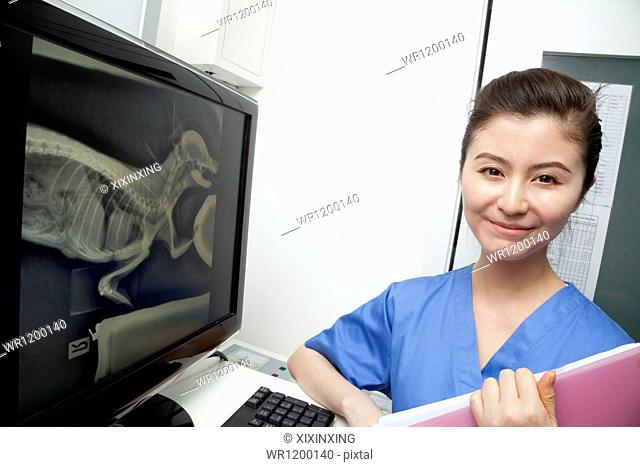 Veterinarian next to animal's x-ray, portrait