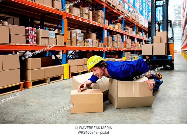 Worker lying on boxes