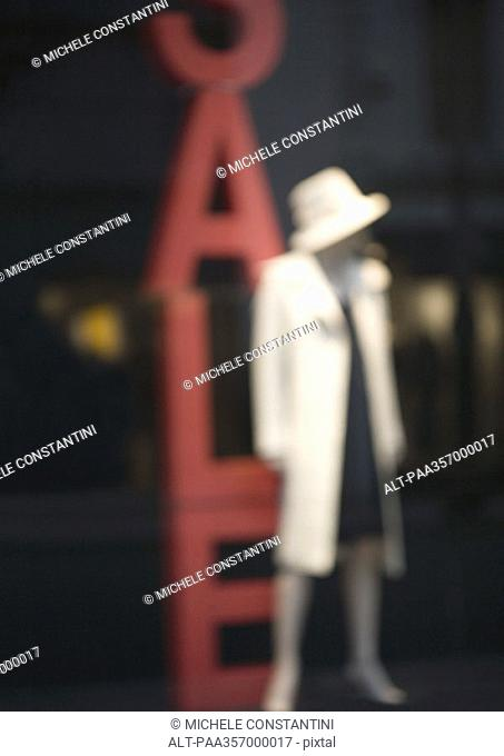 Mannequin and sale sign
