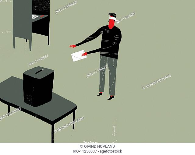 Man wearing blindfold holding voting paper looking for ballot box