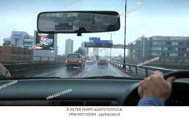 Driving on a rainy wet day with poor visibility and spray on the elevated section of the M4 Motorway., near to Chiswick in west London