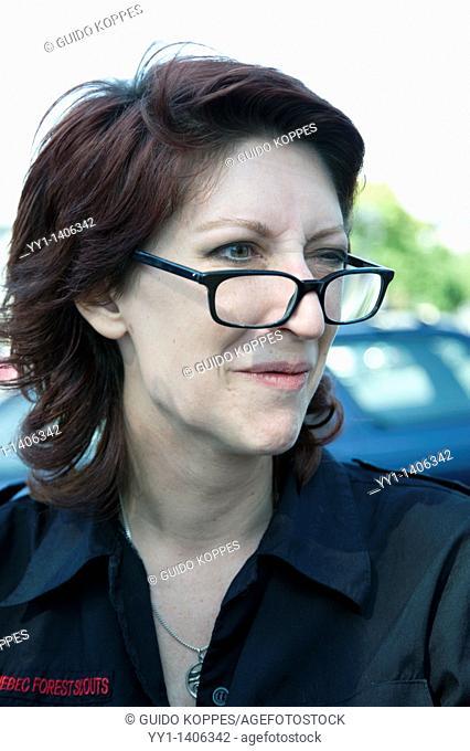 Rotterdam, Netherlands. Portrait redheaded woman wearing glasses