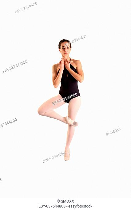 beautiful young ballerina dancing isolated on a white background