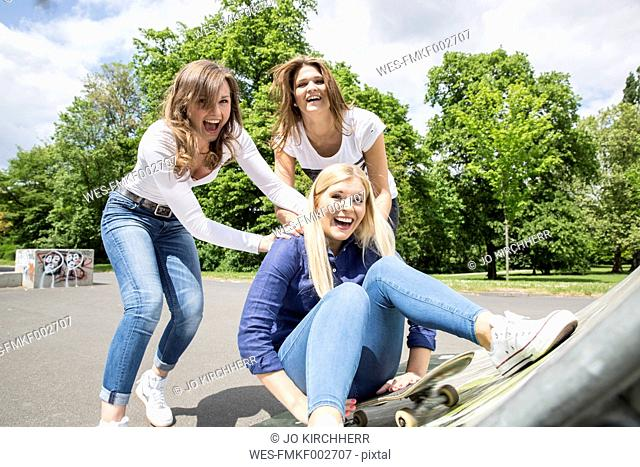 Three young woman having fun together
