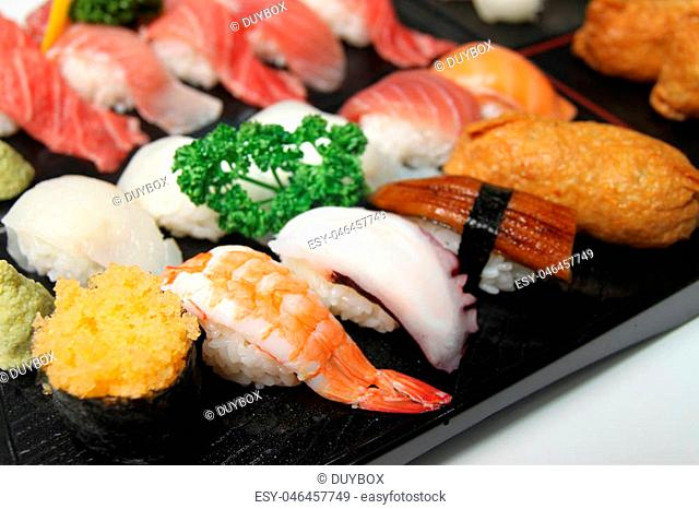 Wooden tray of sushi with shrimp, octopus and tuna