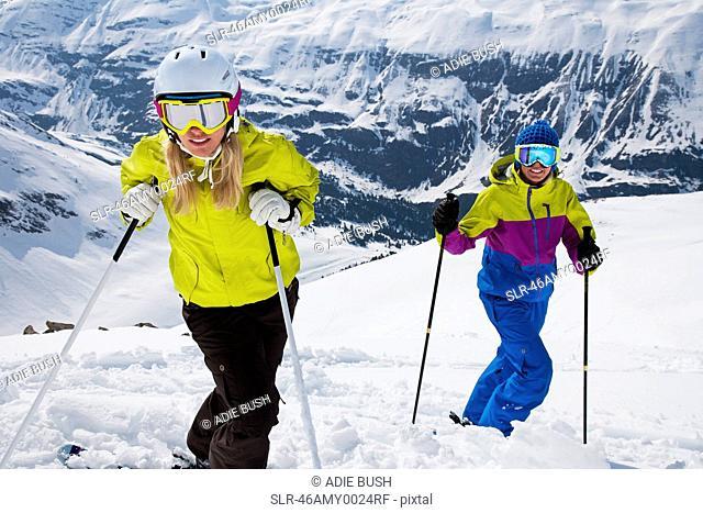 Skiers standing on snowy slope