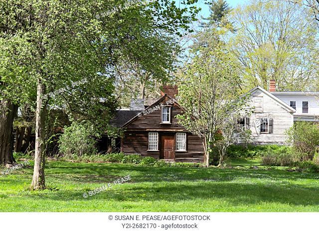 Old buildings seen through spring leaves in the village of Old Deerfield, Deerfield, Massachusetts, United States, North America