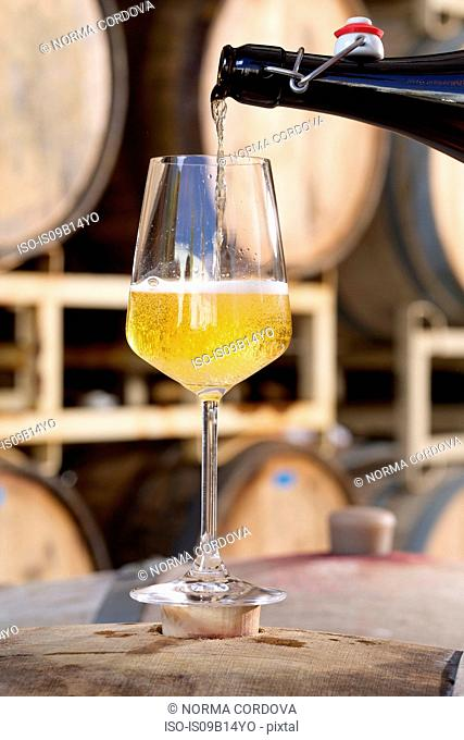 Apple cider being poured into glass