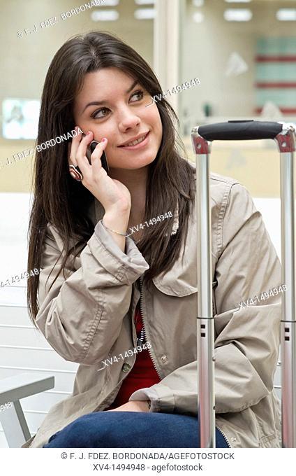Teenage girl waiting in train station