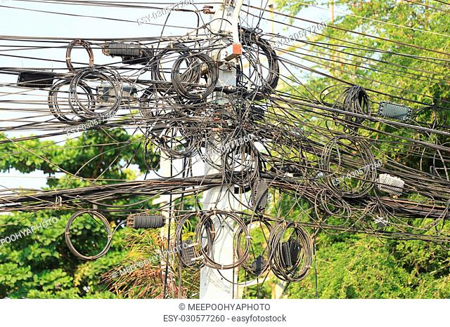 Messy cable electricity post due to poor planning on installing the cable system