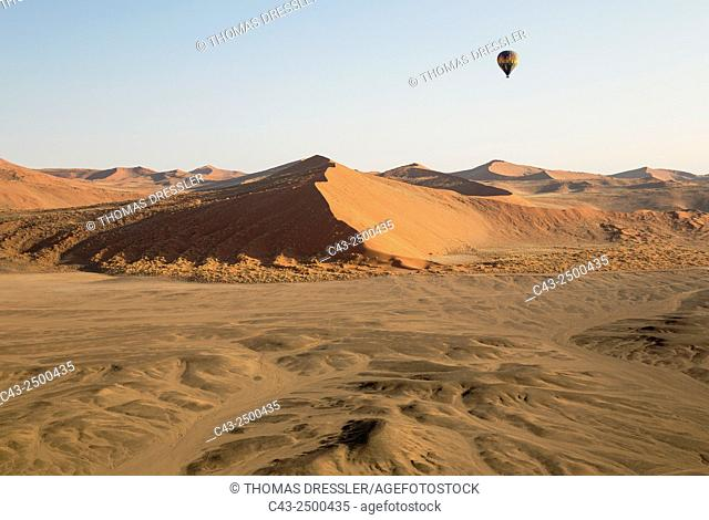 The hot-air balloon above the sand dunes of the Namib Desert. Photographed from a second balloon. Namib-Naukluft National Park, Namibia