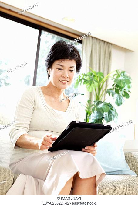 Senior woman using tablet PC