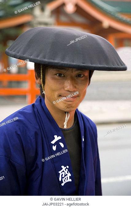 Rickshaw owner outside the Heian Shrine, Kyoto, Honshu, Japan