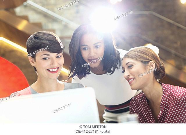 Businesswomen using laptop in office