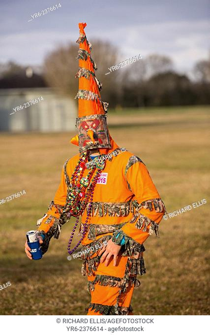 A reveler wears traditional Cajun Mardi Gras masks and costumes during the Courir de Mardi Gras chicken run on Fat Tuesday February 17, 2015 in Eunice