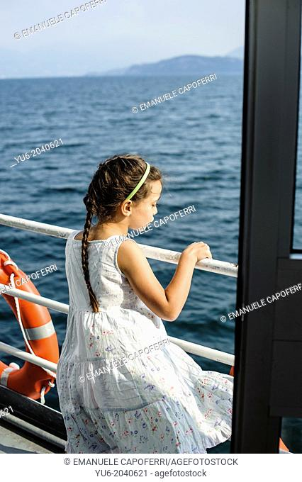 Children navigate on the steamer on Lake Maggiore, Italy