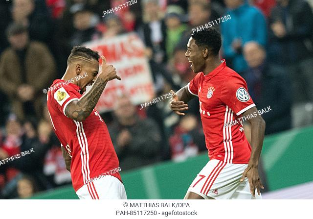 Bayern Munich's David Alaba (R) celebrates a goal with teammate Jerome Boateng during the second round DFB-Pokal game against FC Augsburg in the Allianz Arena...
