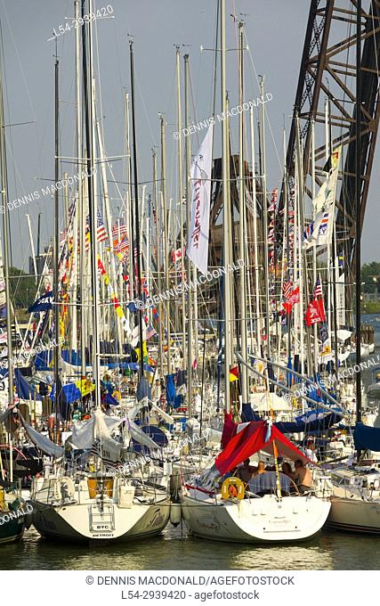 Sailboats and masts moored in the Black River port Huron Michigan