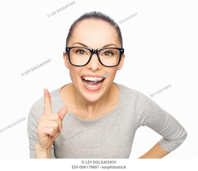 happiness and gesture concept - smiling asian woman in eyeglasses with finger up