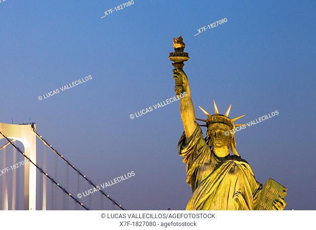 Statue of Liberty replica and Rainbow Bridge in Odaiba Tokyo city, Japan, Asia