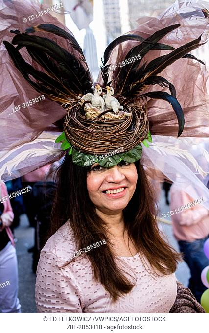 New York, NY - April 16, 2017. A woman wih a hat topped by a bird's nest with chicks, and with a huge spray of feathers and gauze