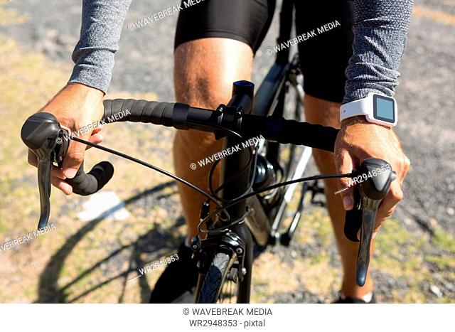 Midsection of athlete riding bicycle