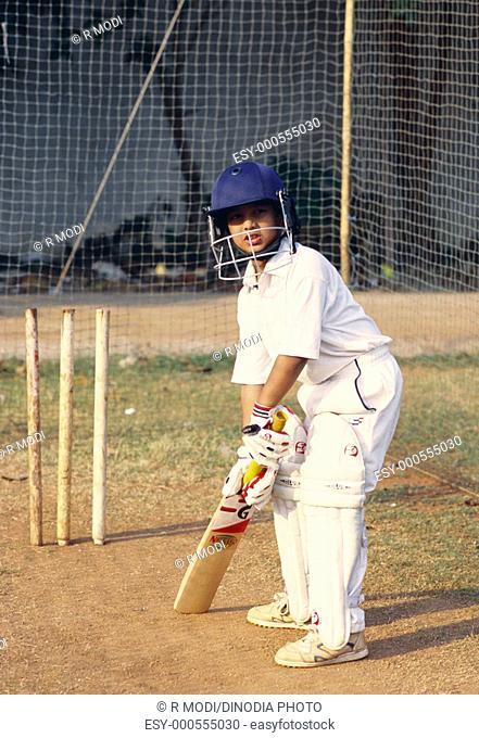 Boy playing cricket MR152