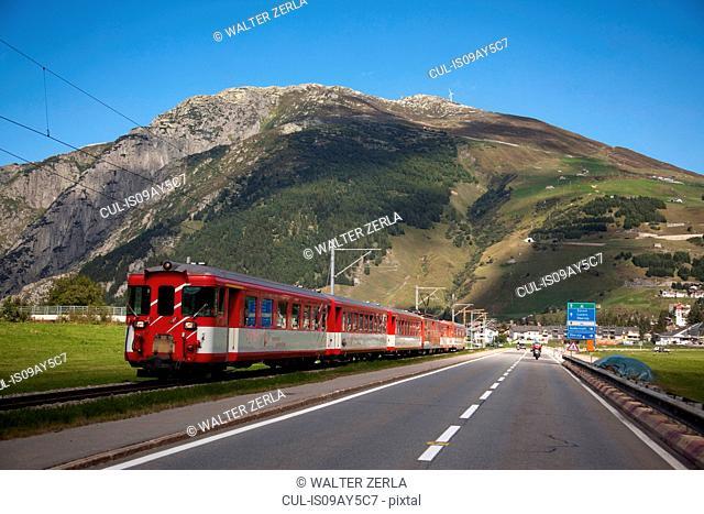 Train running parallel to road, Gotthard Pass, Ticino, Switzerland