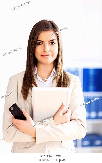 Young businesswoman holding digital tablet and mobile phone, Debica, Poland
