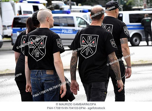 Right-wing extremists walk across the street to commemorate the 30th anniversary of the death of Hitler·s deputy Rudolf Hess at the Spandau train station in...