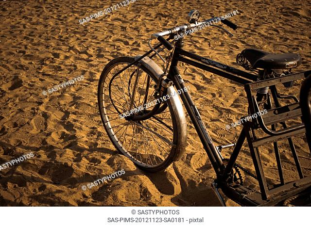 Cycle rickshaw on sand, Pushkar, Ajmer, Rajasthan, India