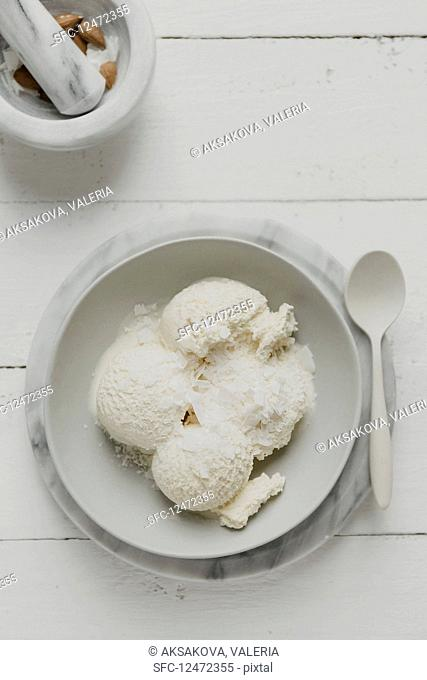 Vanilla and coconut ice cream with grated coconut