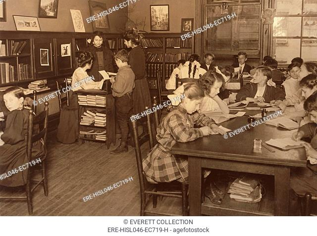Primary and Middle school children in the Library of the Henry Street Settlement House, May 1910. It offered young people nice place after school