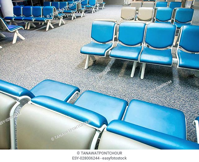 Row of chairs in airport at night