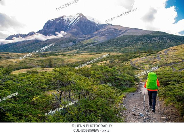 Female hiker on the way up to Torres del Paine National Park, Patagonia, Chile