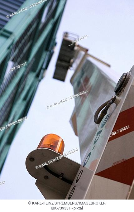 Window washer cleaning the glass facade of a building in Berlin, Germany
