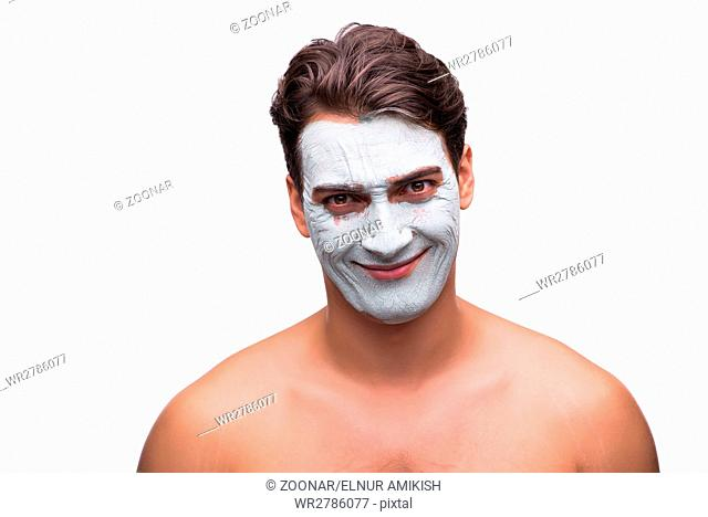 Man with mud mask isolated on white