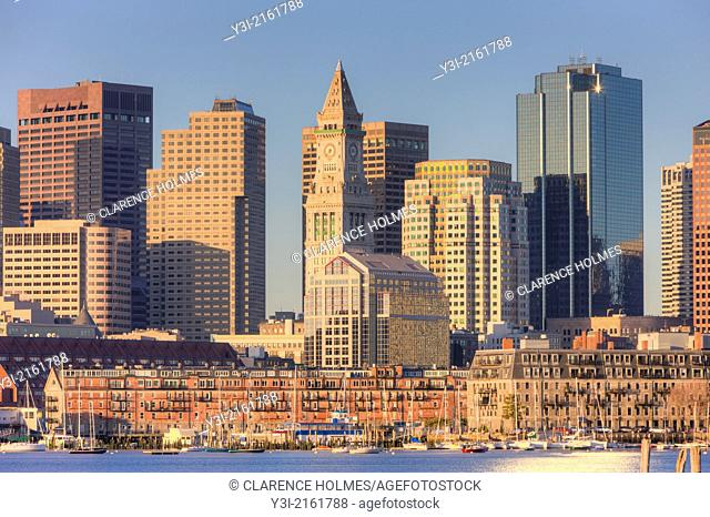 Early morning light reflects off the Custom House Tower, skyscrapers in the Financial District, and low rise wharves on the waterfront which make up part of the...
